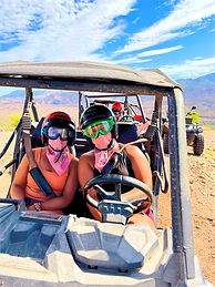 Couple girls in a side by side on a desert tour