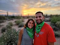 Couple in the Arizona desert watching the sunset