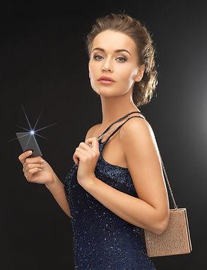 luxury, wealth, premium membership, nightlife concept - beautiful woman in evening dress w