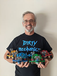 Mr. Radu poses with robot cars