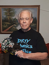 Mr. Rick poses with robot car