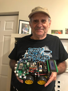 Mr. Keith poses with robot car