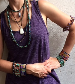 Woman modeling crystal and bead jewelry