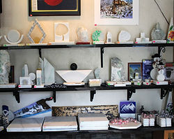Shelves of Marble souvenirs, painted and carved
