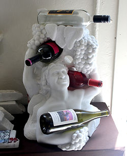 Bacchus and grapes wine rack carved from marble