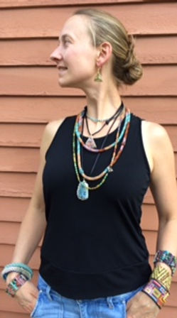 Woman modeling beadwork jewelry