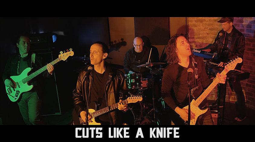 Cuts like a knife band.jpg