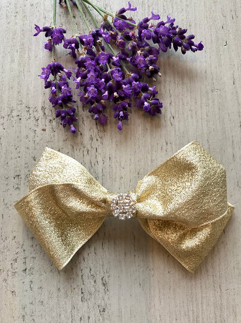 Gold sparkly party bow