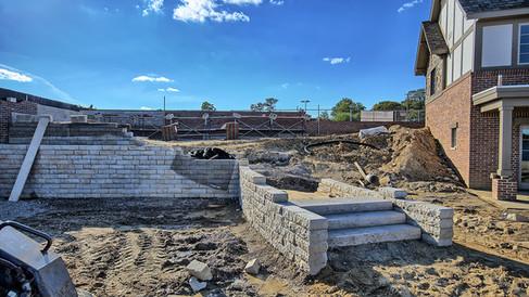 pool house retaining walls & steps looki