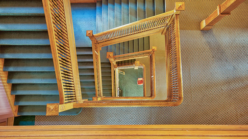 staircase looking down from 4th floor