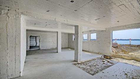 Basement new concrete floor view one