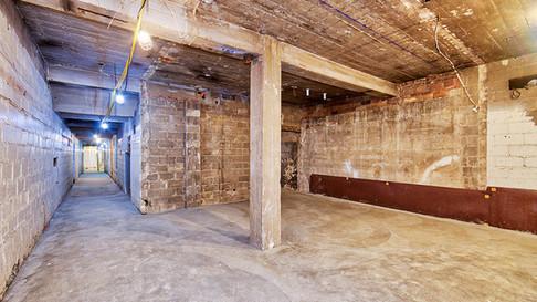 basement hall & open area - new concrete floor looking S