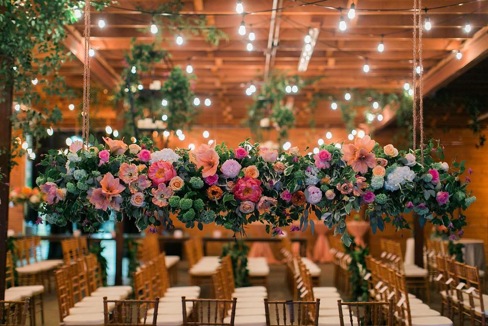 Suspended floral design on ladder
