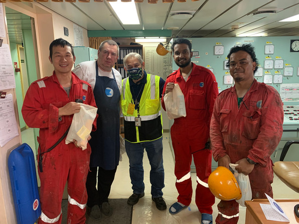 Decon Joey and crew from the NYK Delphinus.