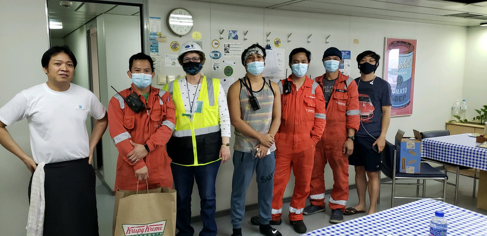 Barbara with crew on the E.R. Tianping. It was nice seeing them again!
