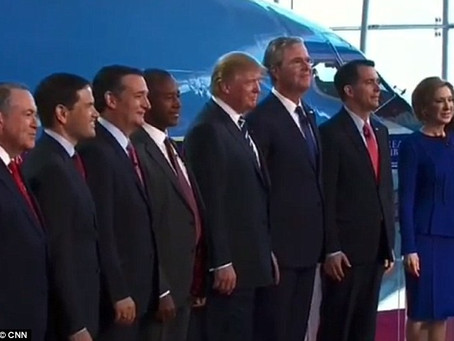 Jeb Bush stands on tip toes in an effort to beat Trump at something