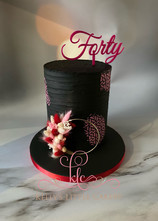 All black and pink cake with dried flowe
