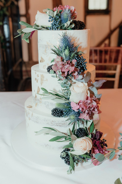 Three tier semi naked rustic wedding cake