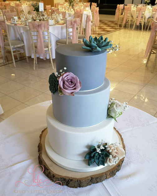 Grey ombre wedding cake, with handmade sugar succulents and fresh roses.