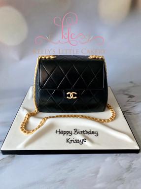 Designer handbag carved cake.jpeg