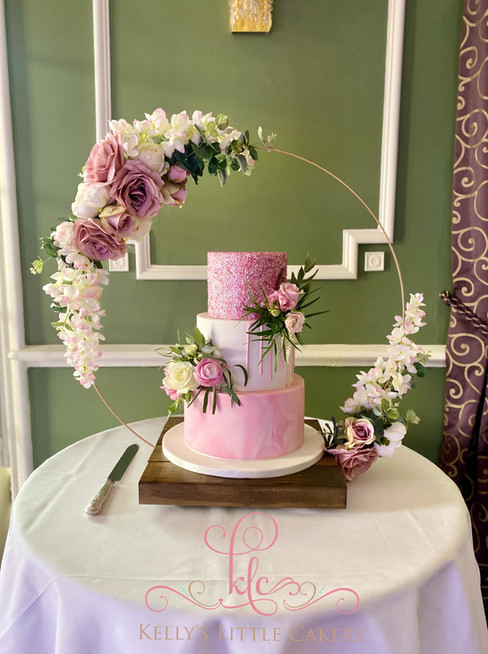 Pink sparkly, marble wedding cake with f