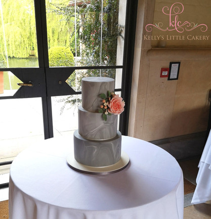 Grey Marble wedding cake with peach sugar flower and foliage