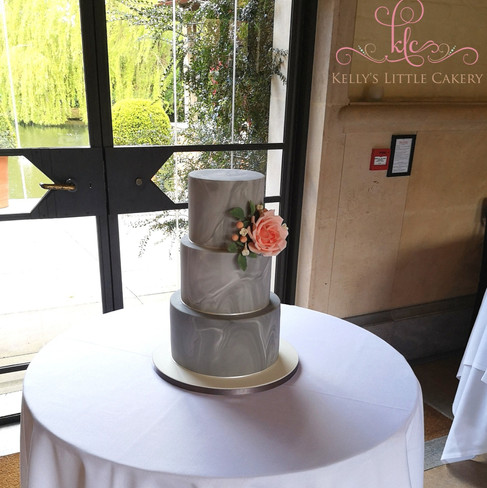 Grey Marble wedding cake with peach sugar flower and foliage