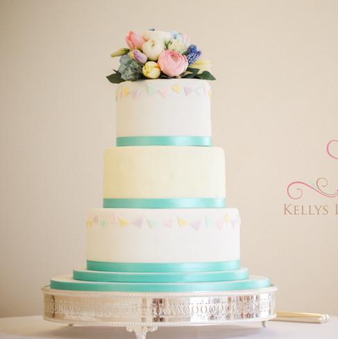 Three tier white and ivory wedding cake