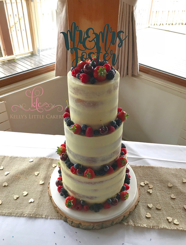 Semi naked rustic wedding cake with fresh fruit