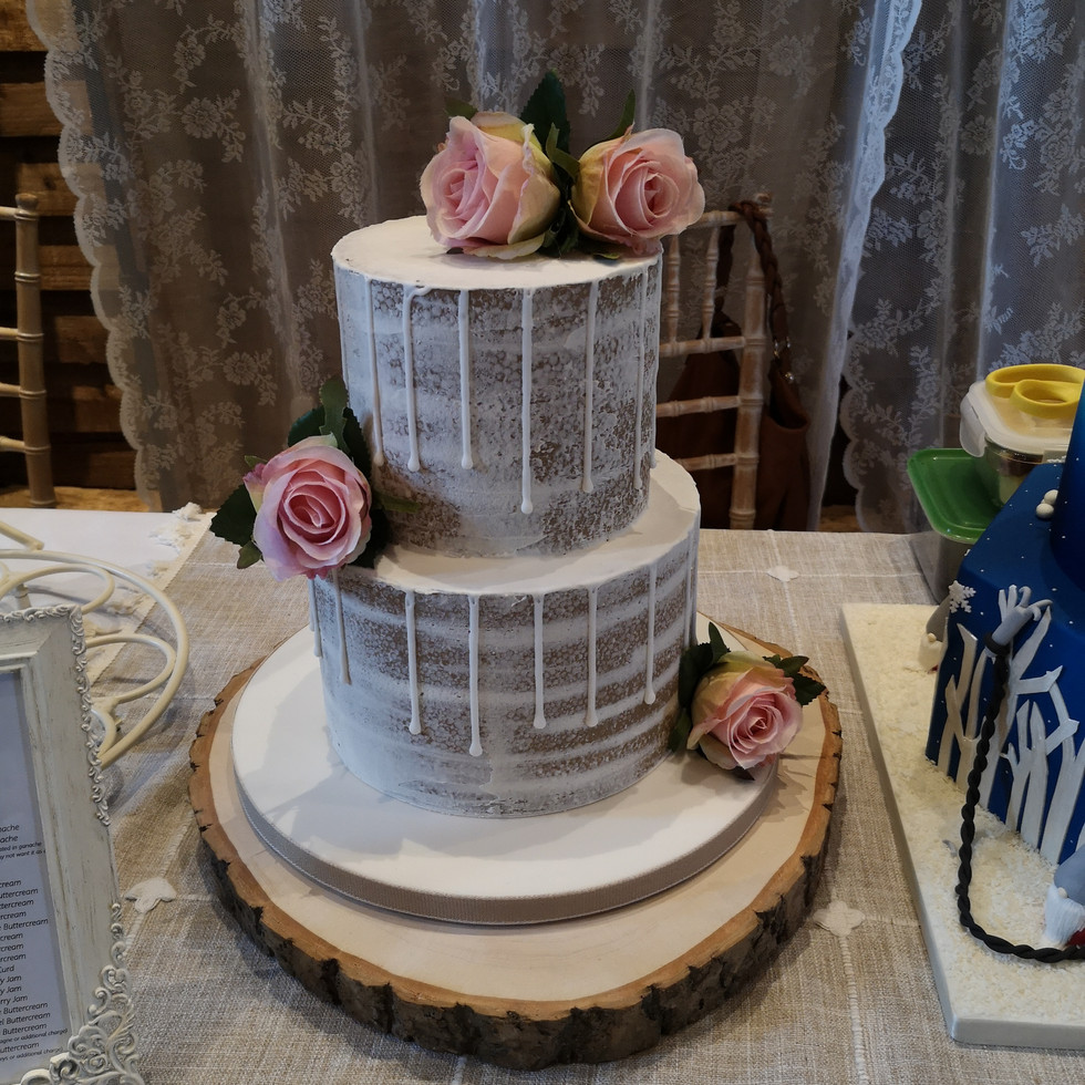 Two Tiered Semi-Naked wedding cake with a drip