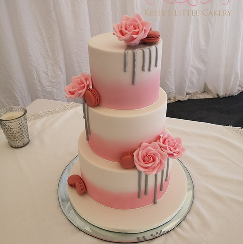 Ombre pink to white wedding cake