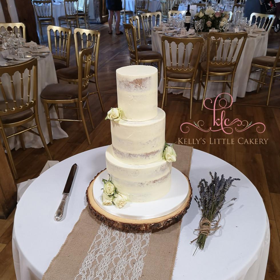 Three tier semi nake rustic wedding cake