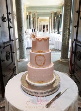 Three tier pale pink vintage wedding cake