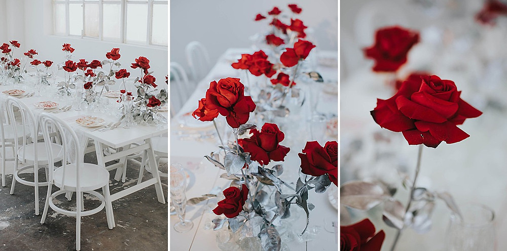 Hochzeitstischdekoration mit roten Rosen