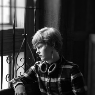 Teen girl looking out window Portrait by Darleen Prem