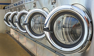 Row of industrial laundry machines in la