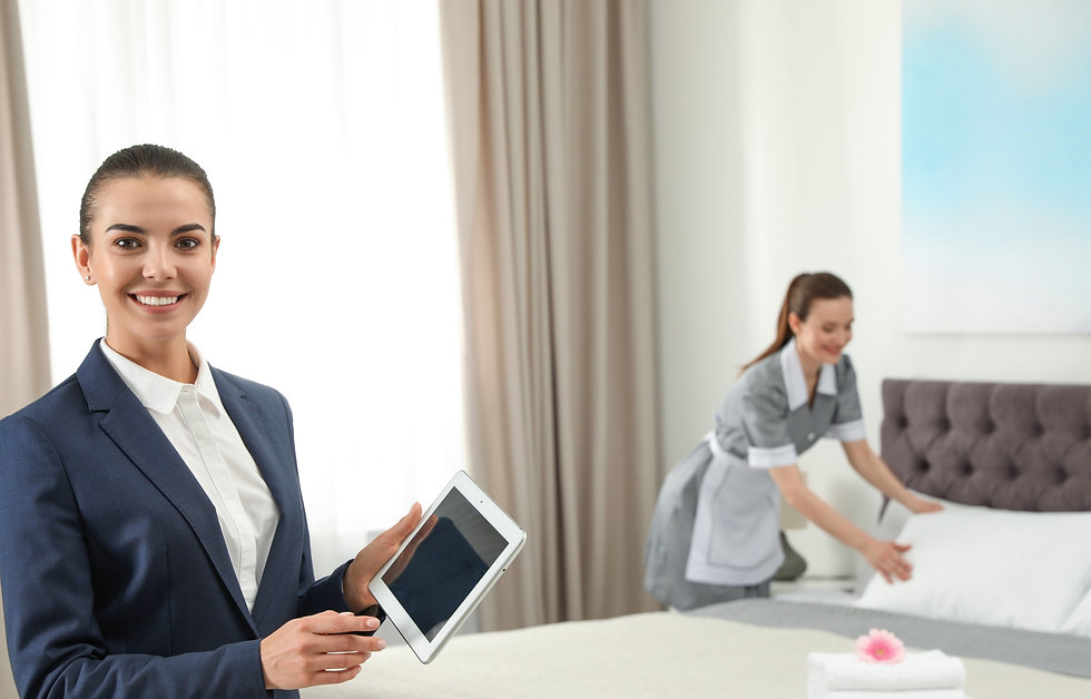 Housekeeping%20manager%20with%20tablet%2