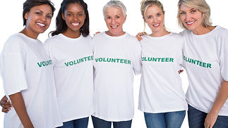 Group%2520of%2520female%2520volunteers%2520smiling%2520at%2520camera%2520on%2520white%2520background