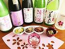 sake bottles with foods sakura.jpg