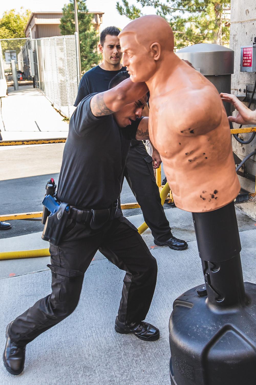 Deputy trainee attacks mannequin after being pepper sprayed.