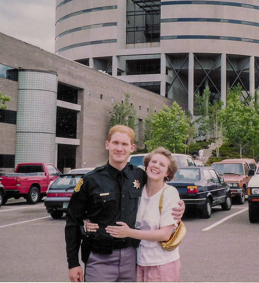 Deputy and wife in front of Sheriff's Office