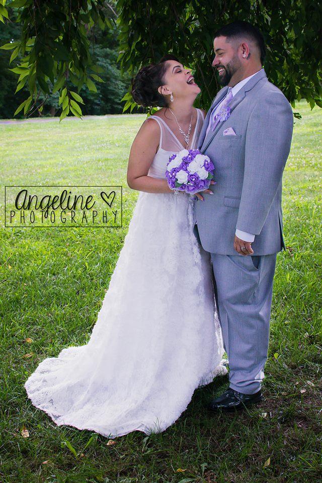bride in groom in park