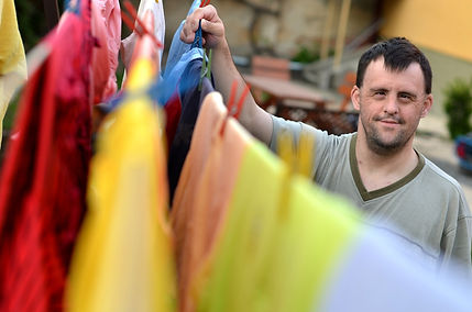 down syndrome man hanging clothes.jpg