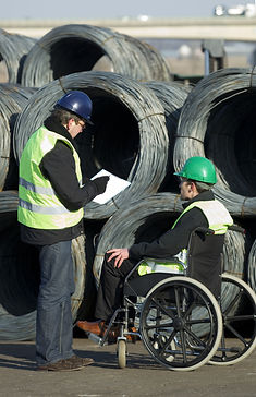 Two workers inspecting at cable wire con