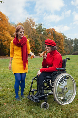 disabled with a friend walking in the au