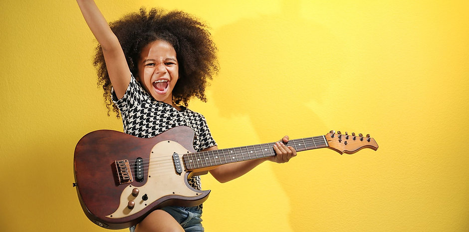 Girl playing donated guitar