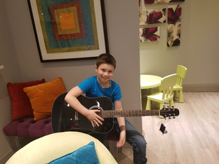 Grayson Loves his New Guitar