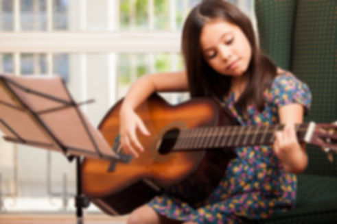 Child Playing Acoustib Guitar | Guitar Lessons | St Albans Student