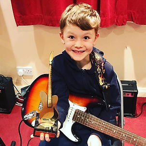 Guitar Student boy with a trophy from St