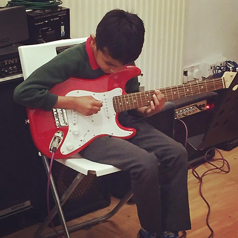 Child Playing Electric Fender Guitar | Guitar Lessons fo Children